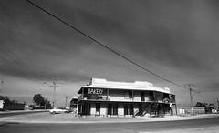1285 (The Dent.) Tags: kodakhawkeyesurveillancefilm south australia coober pedy tmx dev 19 10 mins 2485 analogphotography nikon f100 24mm red filter desert outback wreckage