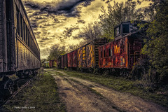 Vanishing into a Dusky Past (jackalope22) Tags: train trsains wooden boone ia graveyard