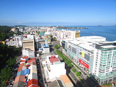 View over Downtown Kota Kinabalu (thienzieyung) Tags: buildings downtown town cbd district grid highrises view morning sunny tropical destinations capital shops roof kotakinabalu jesselton mercure sabah malaysia borneo thienzieyung cars road streets above