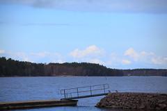 Sitting on the dock of the bay (iorus and bela) Tags: sweden zweden april iorus bela roos lake lago meer see swedishlake torso vanern lakevanern island