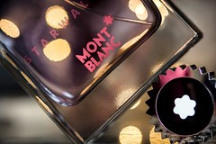 Parfum... (ChusPS) Tags: macromondays macro nikon tamron90mm color light bokeh readyfortheday bottle closeup
