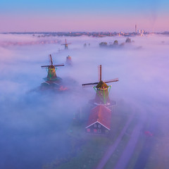 Rising Windmills (albert dros) Tags: fog mist netherlands dutch windmill windmills magic atmopshere albertdros zaanseschans amsterdam zaandam travel tourism