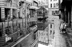 Tram after rain (Drehscheibe) Tags: tram analog nikonf2 reflexe hp5 street gebäude zug blackwhite