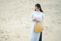 Beautiful vietnamese lady with vietnam culture traditional dress standing at a white sand Mui ne, Ho Chi Minh City Vietnam (Patrick Foto ;)) Tags: aodai hochiminh asia asian attraction background beautiful beauty blue clear colorful conical culture desert dress dune dunes female girl hair happy hat hill lady landmark landscape lifestyle model mui nature ne outdoor people person portrait red sand sky summer sunny tourism tourist traditional travel vietnam vietnamese walk white woman young thànhphốphanthiết bìnhthuận vn