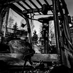Judgement day (Samuli Koukku) Tags: monochrome bw blackwhite destroyed burned forklift filmphotography fuji acros hasselblad 500cm 80mm planar analog 6x6 mediumformat zeiss