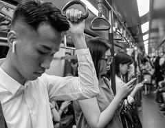Commuters (Ding Yuin Shan) Tags: mtr pentaxk01 tamron175028diii commuters passengers subway hongkong streetphotography blackandwhite monochrome publictransportation