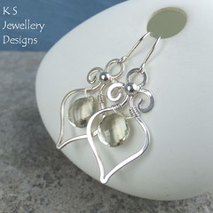 Scapolite Swirly Drops Sterling Silver Earrings (KSJewelleryDesigns) Tags: metalwork gemstoneearrings dropearrings wireworkearrings earrings jewellery jewelry handmade brightsilver shine sterlingsilver handcrafted silver silverwire metal delicate hammered shiny polished bright wrapped wirewrapped smooth faceted sparkling wirework wirewrapping coiled tutorial beads wire forged coldforged frame gemstone rondelle flower petal briolette