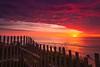 Stunning Red Sunrise Clouds (Dapixara) Tags: travel fence morning coastal ocean clouds stunning sunrise marvelous nauset light beach red sky dramatic capecod outdoors dapixara photography massachusetts usa