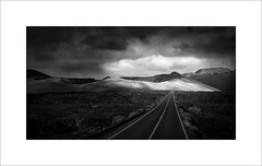 The road through (tkimages2011) Tags: olympus digital camera mono monochrome landscape sky clouds road mountains timanfaya lanzarote sun outside outdoors em10