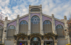 Where shopping is a pleasure (Adaptabilly) Tags: façade arch building window shopping clouds column tile spain text travel wall market decoration sky tree sign mercatcentral valència architecture lumixgx7 europe