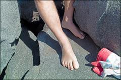 (Back On My Feet Again) (Robbie McIntosh) Tags: leicam9p leica m9p rangefinder streetphotography 35mm leicam autaut candid strangers leicaelmarit28mmf28iii elmarit28mmf28iii elmarit 28mm seaside rocks man belly fat tan speedo naked feet