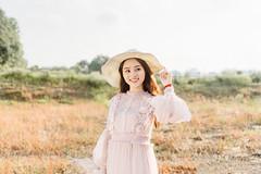 DSC_0158 (tungson.nguyen) Tags: girl woman vietnamese hat backlit dress film portrait sunshine grass