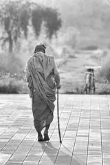 0757 Man And Bike (Hrvoje Simich - gaZZda) Tags: people man outdoors walk old monochrome blackwhite nikon nikond750 nikkor283003556 lumbini nepal asia gazzda hrvojesimich