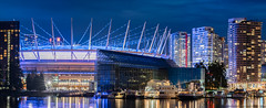 Purple Haze (Sworldguy) Tags: bcplace vancouver downtown skyline purple bluehour reflections casino condos lumination boats marine falsecreek cityscape citylights cityscene vancity sonya73 panorama pano wideshot nightscene nightlife waterfront architecture venue entertainment sports facility whitecaps bclions britishcolumbia bc canada landscape landmark
