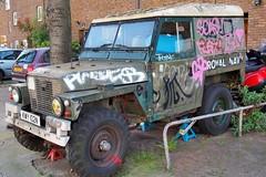 Royal Navy (former) Land Rover Series IIA Lightweight - Brick Lane, Shoreditch, London E2. (edk7) Tags: olympusomdem5 edk7 2018 uk england london londone2 shoreditch hoxton bricklane royalnavylandroverformer series2alightweight seriesiialightweight landroverhalfton swb car vehicle truck suv military graffiti pavement city cityscape urban