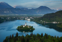 View of Lake Bled from Ojstrica (Ian Middleton: Photography) Tags: bled lake slovenia church island ojstrica viewpoint tower bell history historic mountains alpine building christianity christian clouds stunning scenic travel architecture architectural religious attraction slavic slovene former beautiful popular water european scenery europe vacation holiday touristy yugoslavia slovenian gorenjska famous reflection shimmering tourist tourism
