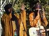 Giving Thanks (mikecogh) Tags: hackney botanicpark womadelaide 2018 tinariwen mali traditional dress costume grateful bodylanguage gratitude golden
