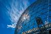 Le troisième oeil/The third eye/Det tredje ögat (Elf-8) Tags: sun halo sky cloud montreal biosphere architecture sphere cosmic cosmos