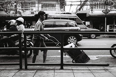 Going Against The Flow (D. R. Hill Photography) Tags: bangkok thailand asia southeastasia city urban street streetphotography blackandwhite monochrome grain film analog 135 35mmfilm people road contax contaxg1 g1 carlzeissplanar35mmf2 planar zeiss 35mm primelens fixedfocallength kodak kodakfilm kodaktrix400 trix