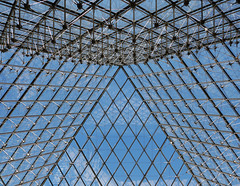 Precision interior framework of the Louvre Pyramid (Monceau) Tags: inside lookingup metal framework glass sky blue louvre pyramid muséedulouvre 12precision 118picturesin2018 pattern lines diamonds reflections