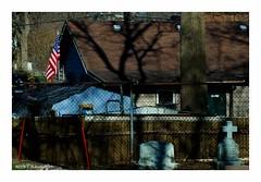 That Down Home Feeling (TooLoose-LeTrek) Tags: cemetery cross grave headstone neighborhood flag usa house