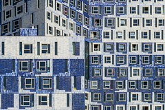Girl in a blue building (Maerten Prins) Tags: netherlands nederland utrecht uithof campus universiteit university student residence modern building blue window windows lines structure grid