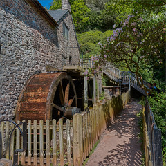 One of the two waterwheels at Dunster Mill. (WatsonMike) Tags: british countryside dunster england english europe exmoor exmoornationalpark gb greatbritain ipsv0450 ipsv0462 mill milllane somerset stream tourism uk unitedkingdom vintage water wood building flow historic old power river rustic traditional watermill waterwheel waterwheels wheel wooden