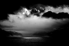 Comme de longs échos... (Sabine-Barras) Tags: suisse switzerland lake lac landscape paysage ciel sky clouds nuages dark sunset monochrome blackandwhite bnw bw water eau argentique argentic montagnes mountain