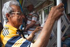 Newspaper (Mikpletnev) Tags: old man glasses reading newspaper tram transportation people street streetphotography