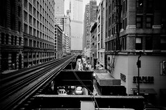 Rail (Crawford Brian) Tags: rail railroad transit cta chicago chicagotransitauthority city urban masstransit buildings architecture brands bw blackandwhite monochrome film analog ffp kodak 35mm illinois midwest trump