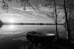 Sunset in b&w (Antti Tassberg) Tags: reflection landscape pitkäjärvi serene järvi laaksolahti auringonlasku bw hdr vene espoo suomi kevät aurinko blackandwhite boat finland lake monochrome scandinavia spring sun sundown sunset