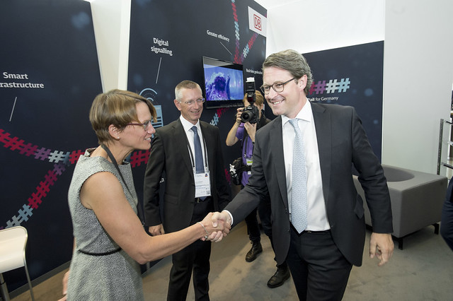 Franziska Fuchs greeting Andreas Scheuer at the Deutsche Bahn stand