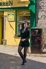 Dancing in the street - downtown Galway. (jonjodun) Tags: dancing street galway girl busking green smile irish