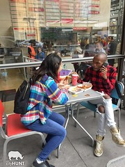NYC Scavenger Hunt Photo (realcityhunt) Tags: restaurant sidewalk food eat share talk table chairs sit sitting friends fashion plaid gold goldshoes backpack people hungry cellphone lady woman man pose challenge scavengerhunt nyc newyorkcity teamwork teambuilding corporateevent cityhunt