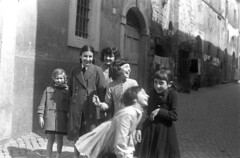 1959-3 35 (ndpa / s. lundeen, archivist) Tags: nick dewolf nickdewolf blackwhite photographbynickdewolf bw 1959 1950s film 35mm monochrome blackandwhite italy italian europe streetphotography tarquinia town viterbo lazio building buildings architecture homes alley street group children kids child girl girls localchildren smile smiles smiling laugh laughing laughter people laundry clothesline clotheslines