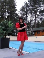 Twisting (Paula Satijn) Tags: girl hot sexy red skirt dress miniskirt tgirl gurl lady garden pool outside happy fun joy sensual sweet cute girly feminine legs stockings pumps heels drink tranny transvestite smile