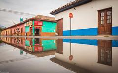 Duplo (Eugercios) Tags: putaendo valparaiso chile rural calle street reflejo reflexo reflection agua water bike bici bicicleta casas houses stop america sudamerica southamerica hispanoamerica grey gris mirror espejo
