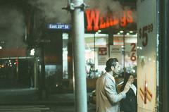 wed night, 2AM, midtown: well-groomed suit, fast food, and the downtown steam (on ektachrome film) (NYC Macroscopist) Tags: 50mm street nyc night film vintage midtown leica analog manhattan newyork stream ektachrome2239 retrochrome160 nightcrawlers ektachrome summilux moody atmospheric