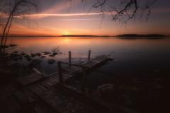 May (petrisalonen) Tags: landscape rocks atmosphere finland nature sky clouds orange yellow filter night red art light sun järvi lake maisema saimaa reflection