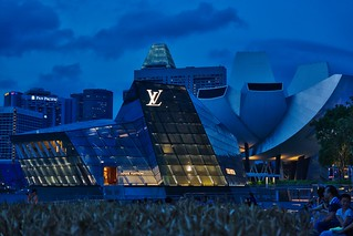 Louis Vuitton pavilion and Arts and Sciences museum at Marina Bay at dusk in Singapore