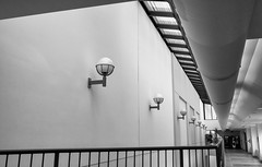 'Ljus reser inte i en rak linje ... ' (Canadapt) Tags: lamp railing pipes vendingmachines hallway bw tile windows hospital timmins canadapt