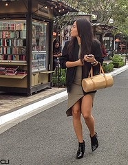 Looking... (ClearlightImagery) Tags: asymmetrical minidress handbag boots legs streetfashion streetphotography youngwoman