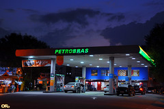 Gas station at night (Otacílio Rodrigues) Tags: posto gasstation combustíveis carros cars noite night luzes lights céu sky bluehour pessoas people placas signs urban resende brasil oro petrobras clouds nuvens
