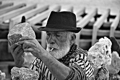 (Roi.C) Tags: people man cigarette hat work artist stones stone outdoor blackwhite blackandwhite bw black white monochrome candid light europe portugal lisbon nikkor nikon nikond5300 portrait