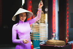 Vietnamese woman in traditional dress praying with incense stick in the burning pot of the Chinese temple, Ho Chi Minh Vietnam (Patrick Foto ;)) Tags: ao asia asian attractive background beautiful beauty buddhism buddhist burning chi china chinese culture cute dai dress face fashion female girl ho holding incense lady minh model people portrait pray pretty religion religious saigon smoke stick temple tourism tourist tradition traditional travel two vietnam vietnamese woman women worship young hochiminhcity hồchíminh vn