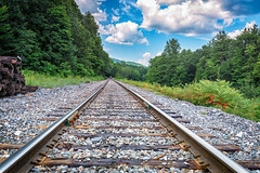 Vermont Train Tracks (mikewhalenphotography) Tags: train tracks leading sky clouds trees rocks lumber nature outdoors outside walking walk transportation rural landscape country activity
