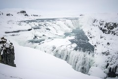 Tourist (Thomas James Caldwell) Tags: iconic hvítá river golden falls circle iceland winter snow ice waterfall cold tiered stark nature landscape sky rock white water tourist staircase famous dramatic echo bunnymen gorge crevice harsh rocks icy february