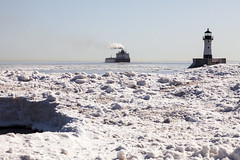 Spring in Duluth (Lucie Maru) Tags: duluth minnesota lake ice frozen lakesuperior north cold spring icepancakes iceformations iceonlake float floating landscape icelandscape snow harbor duluthharbor lighthouse