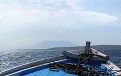 Heading out to Menjangan Island, Bali (scinta1) Tags: bali menjangan island temples boat ferry sea ocean blue choppy anchor ropes mountain volcano bow clouds sky haze