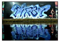 STREET ART by LOVEPUSHER (StockCarPete) Tags: lovepusher streetart londonstreetart urbanart graffiti reflection canal hackneywick bike cyclist first londonlettering london uk